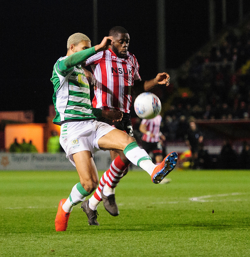 Lincoln City's John Akinde vies for possession with Yeovil Town's Omar Sowunmi<br /> <br /> Photographer Chris Vaughan/CameraSport<br /> <br /> The EFL Sky Bet League Two - Lincoln City v Yeovil Town - Friday 8th March 2019 - Sincil Bank - Lincoln<br /> <br /> World Copyright © 2019 CameraSport. All rights reserved. 43 Linden Ave. Countesthorpe. Leicester. England. LE8 5PG - Tel: +44 (0) 116 277 4147 - admin@camerasport.com - www.camerasport.com