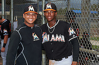 GCL Marlins Jose Quijada (no jersey) and Garvis Lara before the second game of a doubleheader against the GCL Mets on July 24, 2015 at the St. Lucie Sports Complex in St. Lucie, Florida.  GCL Marlins defeated the GCL Mets 5-4.  (Mike Janes/Four Seam Images)