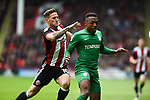Billy Sharp of Sheffield Utd battles with Darnell Fisher of Preston North End during the Championship league match at Bramall Lane Stadium, Sheffield. Picture date 28th April, 2018. Picture credit should read: Harry Marshall/Sportimage