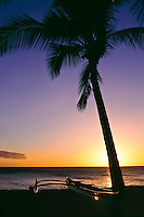 Outrigger canoe at sunset on the beach on Maui in Hawaii