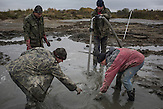 """Illegaler Bernsteinabbau in Chrabowo, Region Kalinigrad. /<br />""""Black diggers"""" dig for amber in makeshift pools outside the village of Khrabrovo, Kaliningrad region, Russia. Despite fines, confiscation of expensive pumps and cars and even criminal prosecution """"black digging"""" remains a popular occupation in Kaliningrad."""
