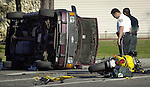 HILLSBOROUGH,TAMPA -- 10/15/03 -- FOR METRO STORY BY MORELLI SLUGGED: FATAL16--HCSO Deputies work the scene of a fatal accident on Sheldon Road at Mohr Road. A motorcycle was southbound on Sheldon when the van turned left in front of the motorcycle on Mohr Road. The motorcycle hit the right rear section of the van causing a tire to blow-out.  The driver of the van then lost control and the van rolled onto its side. The motorcycle driver was dead at the scene and the van driver was transported to an area hospital. (staff/Jay Nolan)