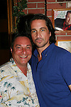 One Life To Live's Michael Easton poses with Al Needleman on July 13, 2008 at Uncle Vinnie's Comedy Club in Point Pleasant, New Jersey. There was entertainment, q & a, and signing of photos and Michael's new book,. a graphic novel (which Melissa is holding) written by Michael and artwork by Christopher Shy. (Photo by Sue Coflin/Max Photos)