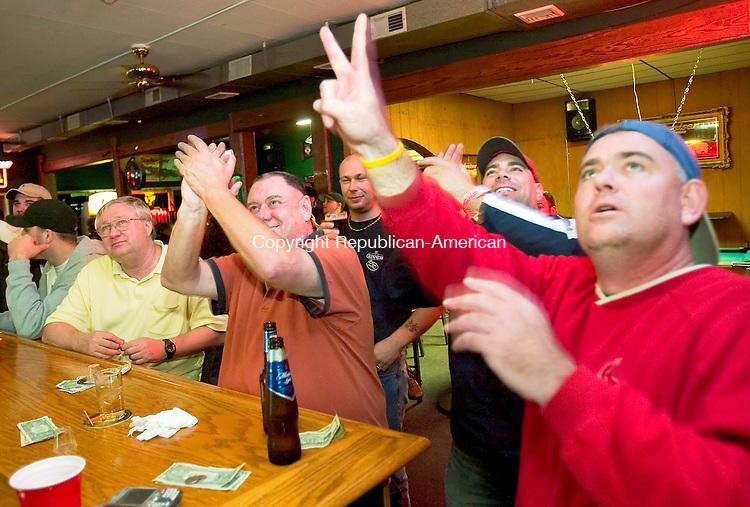 WATERBURY, CT-- 27 OCTOBER 2007--102707JS13-Red Sox fans, from left, Rich Bisnia of Waterbury, Jeff Joyce of Naugatuck, James Gann of Naugatuck, Joe Lombardi of Waterbury and John Mercier of Waterbury celebrate during Game 3 of the World Series while at McFarlawn Tavern in Waterbury. <br /> Jim Shannon / Republican-American