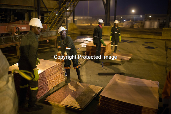 KOLWEZI, DRC- JULY 7: Workers load batches of processed copper at Mutanda Mining Sarl, owned (69%) by Glencore, an Anglo-Swiss multinational commodity trading and mining company on July 7, 2016 in Kolwezi, DRC. These copper sheets are ready for shipping by truck to ports such as Dar es Salaam, Tanzania or Durban, South Africa. The mine is mainly producing copper but also some cobalt. The mine employs about 3,500 people and its located in Luabala Province in Southern DRC. (Photo by Per-Anders Pettersson)