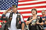 Veteran salutes during the Pledge of Allegiance  at 9-11 Memorial Ride.