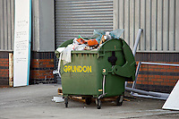 Grundon rubbish container full at the rear of a retail unit UK..©shoutpictures.com..john@shoutpictures.com