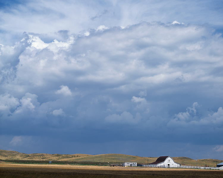 Storm clouds building over a farm near Sutherland; Lincoln County, NE