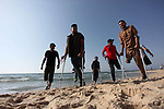 Wounded Palestinians, who were lost their legs during the clashes with Israeli troops, walk on the beach of Gaza city on May 29, 2019. Photo by Mahmoud Ajjour
