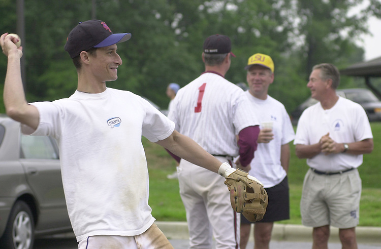 Weiner(TW)071900 - Rep. Anthony Weiner warms up in the Parking lot of Prince George's Stadium.  Wednsday morning practice was cut short due to a wet field.