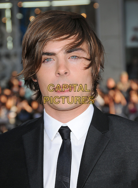 """ZAC EFRON.The L.A. premiere of """"17 Again"""" held at The Grauman's Chinese Theatre in Hollywood, California, USA. .April 14th, 2009.headshot portrait black messy hair windswept tongue funny face  .CAP/DVS.©Debbie VanStory/Capital Pictures."""