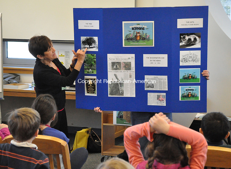 KENT, CT – 21 March 2014 - 032114LMW02 – Author Renee Domogauer shows photographs and newspaper articles about the real Washington Oak in Gaylordsville during a presentation Friday at Kent Center School Her book, 'The Washington Oak Kittens,' was recently published. Domogauer and illustrator Katie Atkinson of Norfolk will be at the House of Books in Kent today (Saturday) at 11 a.m. and Kent Memorial Library at 3 p.m. Lynn Mellis Worthington Republican-American