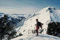 Back-country telemark skier enjoys a breath-taking view in the Wasatch Mountains sports, skiing, male, man, men. Utah, Wasatch Mountains.