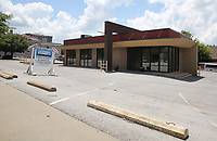NWA Democrat-Gazette/DAVID GOTTSCHALK   The building at 241 College Avenue Thursday, July 13, 2017, in Fayetteville. The property recently housed Jerry's Restaurant and Dead Swanky, a hair salon. St. Paul's Episcopal Church is looking for a tenant after Starbucks and two local buisesses backed out on leasing it.