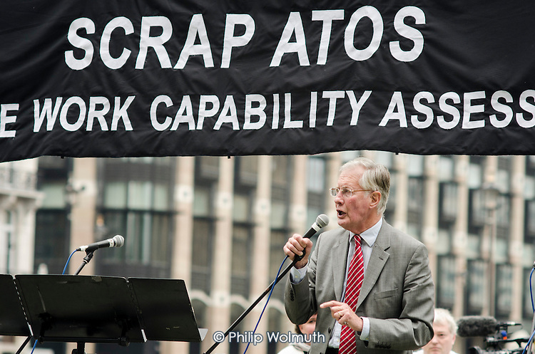 Michael Meacher MP.  10,000 Cuts and Counting memorial service in Parliament Square, London, to commemorate those who have died shortly after undergoing a Work Capability Assessment by government contractor Atos.