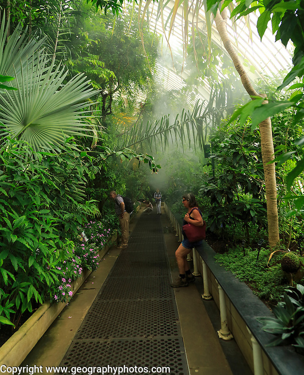 People inside The Palm House at Royal Botanic Gardens, Kew, London, England, UK