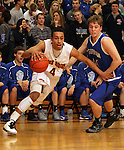 SIOUX FALLS, SD - FEBRUARY 26:  Brandon Boggs #4 from Roosevelt drives against Ben Johnson #40 from O'Gorman in the first half of their District 1AA game Tuesday night at Roosevelt. (Photo by Dave Eggen/Inertia)