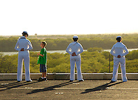 060729-N-7981E-058 Pearl Harbor HI (July 29, 2006)- SKSN Buckingham chats with her Tiger, Noah Tyler while she and other sailors from USS Abraham Lincoln (CVN-72) man the rails during Lincoln's departure from Pearl Harbor HI. Lincoln is currently underway on a Tiger cruise, during which families and friends of the crew are given the opportunity to experience life at sea by embarking aboard the ship for a week. U.S. Navy photo by Mass Communications Specialist Seaman James R. Evans. (RELEASED)