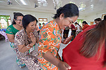 Participants form a circle while giving backrubs during an ecumenical workshop on women's empowerment in Kalay, Myanmar. The workshop was sponsored by the Women's Department of the Myanmar Council of Churches and led by Emma Cantor (second from left), a regional missionary for United Methodist Women.