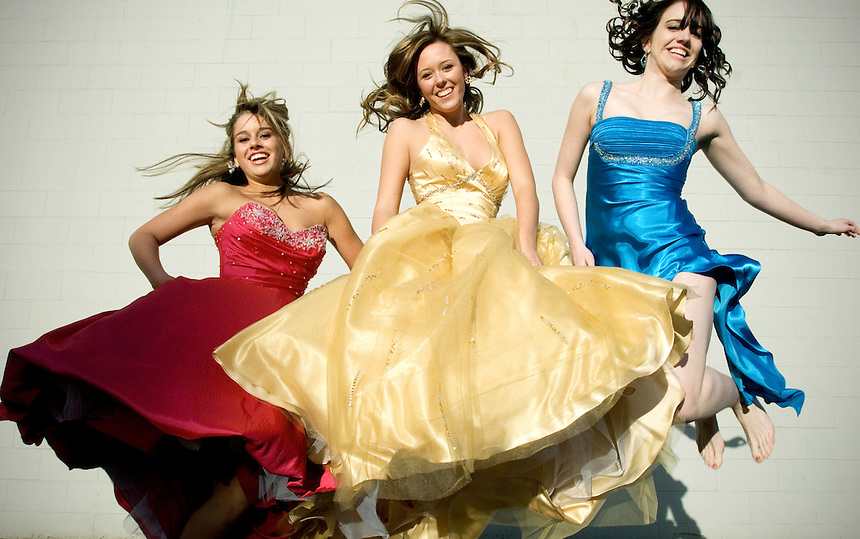 From left, Jessica Saab, Shelby Hart and Adrienne Greer wear dresses that are available at Alicia's Bridal in Bellingham for this year's prom season. Saab is wearing a drop-waisted mermaid gown by Mori Lee available for $298. Hart is wearing a embelished ball gown by Mori Lee available for $378. Greer is wearing a satin column dress with side slit by Faviana available for $318. Photo made on Monday, February 26, 2007..