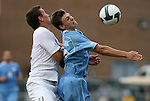06 September 2009: Evansville's Justin Sass (left) fouls UNC's Billy Schuler (right). The University of North Carolina Tar Heels defeated the Evansville University Purple Aces 4-0 at Fetzer Field in Chapel Hill, North Carolina in an NCAA Division I Men's college soccer game.
