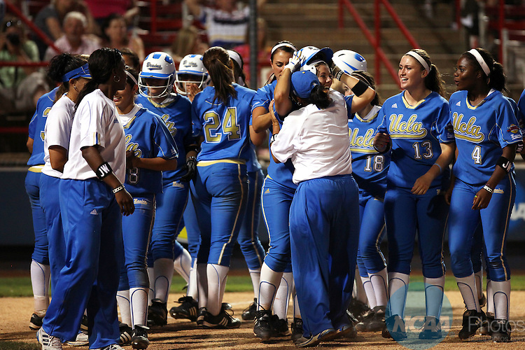 08 JUNE 2010:  Teammates and coaches congratulate Julie Burney (14) of UCLA after her home run against the University of Arizona during the Division I Women's Softball Championship held at ASA Hall of Fame Stadium in Oklahoma City, OK.  UCLA defeated Arizona 15-9 to win the national title.  Stephen Pingry/ NCAA Photos