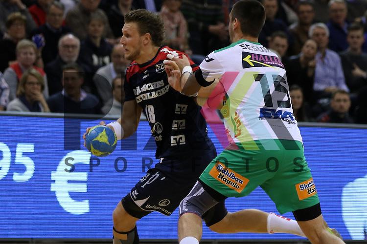 Flensburg, 25.03.15, Sport, Handball, DKB Handball Bundesliga, Saison 2014/2015, 26. Spieltag, SG Flensburg-Handewitt - Frisch Auf! G&ouml;ppingen : Lars Kaufmann (SG Flensburg-Handewitt, #18), Zarko Sesum (Frisch Auf! G&ouml;ppingen, #15)<br /> <br /> Foto &copy; P-I-X.org *** Foto ist honorarpflichtig! *** Auf Anfrage in hoeherer Qualitaet/Aufloesung. Belegexemplar erbeten. Veroeffentlichung ausschliesslich fuer journalistisch-publizistische Zwecke. For editorial use only.
