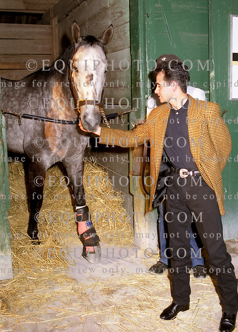 Jockey Mike Smith visits Holy Bull in his stall after injuring his leg in the Donn Hdcp. at Gulfstream Park.  2/11/95..Photo By Bill Denver/EQUI-PHOTO