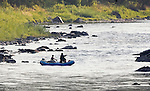 Fishing from a raft on the Blackfoot River in western Montana