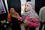 Young women in Gaza participate in a group activity at the Alassria Cultural Center in the Jabalya refugee camp in the Gaza Strip. The center is supported by the American Friends Service Committee, a Quaker organization from the United States...