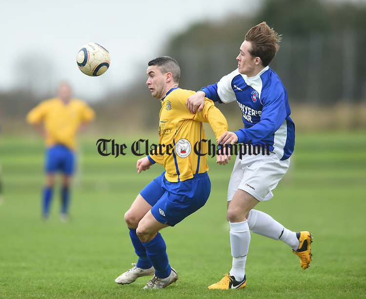 Eoin Hayes of Clare in action against AJ O Connor of Limerick during their FAI Oscar Traynor game in Limerick. Photograph by John Kelly.