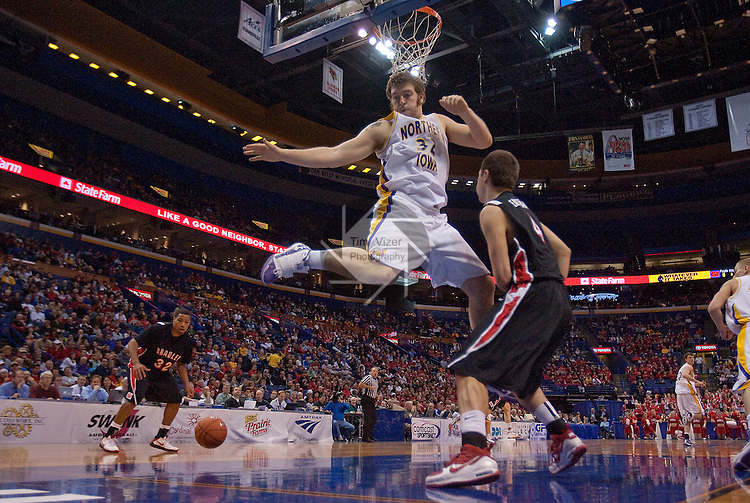 March 6,  2010            Northern Iowa forward Lucas O'Rear (32) soars for a rebound in the second half, but misses.  At right is Bradley guard Jake Eastman (4).  The University of Northern Iowa defeated Bradley University by a score of 57-40 in the first of two semifinals on Saturday March 6, 2010 at Missouri Valley Conference Tournament held at the Scottrade Center in downtown St. Louis.