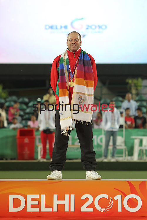 Delhi 2010 Commonwealth Games..Rob Weale (Wales) stands proudly on the winners podium after beating Australian Leif Selby to win the Gold medal in the final of the Mens singles .13.10.10.Photo Credit-Steve Pope-Sportingwales