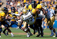 Mychal Kendricks picks up Derrick Coleman (33) on the tackle. The California Golden Bears defeated the UCLA Bruins 35-7 at Memorial Stadium in Berkeley, California on October 9th, 2010.