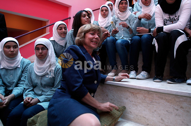 Daniela Schadt, German journalist and partner of German President meets schoolgirls during the inauguration of a new girls school in the West Bank village of Burin, Thursday, May 31, 2012. Photo by Wagdi Eshtayah