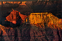 749220284 late afternoon light creates a reddish glow on the ancient geological formations including wotons throne along the north rim of grand canyon national park in northern arizona