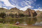 Woman, dog and raft on the John Day River, Oregon.