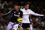 VALENCIA, SPAIN - JANUARY 20: (L) Raphael Varane of Real Madrid CF competes for the ball with (R) Jonas of Valencia CF during the Liga BBVA between Valencia CF and  Real Madrid CF at the Mestalla Stadium on January 20, 2013 in Valencia, Spain. Photo by Aitor Alcalde / Power Sport Images.