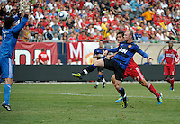 Manchester United forward Wayne Rooney (10) chips the ball over Chicago Fire goalkeeper Jon Conway (1) to score Manchester United's first goal.  Manchester United defeated the Chicago Fire 3-1 at Soldier Field in Chicago, IL on July 23, 2011.