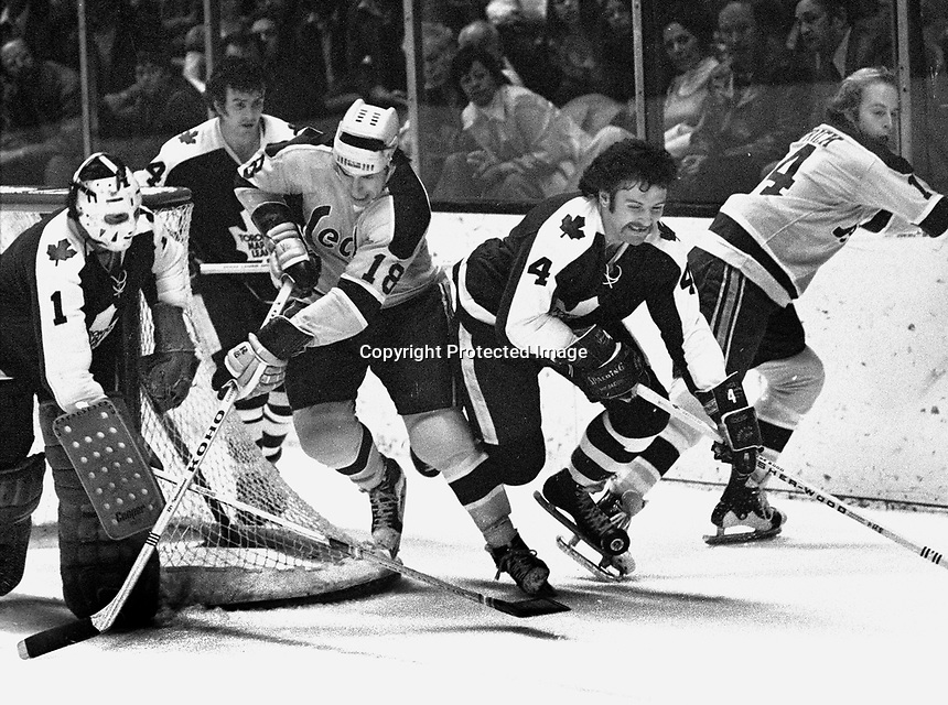 California Golden Seals vs. Toronto Maple Leafs,  Gary Croteau, and Craig Patrick..Leafs goalie Eddie Johnson, and #4 Mike Pellyk. (1973 photo/Ron Riesterer)