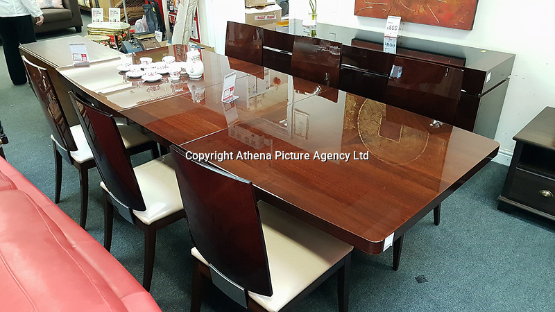 Pictured: The dining table with six chairs at the British Heart Foundation charity shop in Swansea, Wales, UK. Wednesday 12 April 2017<br /> Re: A mystery Swansea woman has donated £16,000 worth of furniture to a charity shop.<br /> The British Heart Foundation shop in Kingsway in Swansea has benefitted from the haul.<br /> Some of the furniture is so new, that similar items are still for sale with the original retailer; Furniture Village.<br /> The haul includes a side board, a display cabinet, two two-seater sofas, a three seater sofa and dining table complete with six chairs.<br /> The dining table is listed online with Furniture Village for £1,865, the display cabinet for £1,865, and a pair of the six dining chairs for £1065.<br /> The British Heart Foundation will be selling the items for probably around a quarter of the original value.