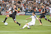LA Galaxy midfielder Landon Donovan (10) makes a pass while cover by DC United defender Devon McTavish (18). LA Galaxy defeated DC United 2-1 at RFK Stadium, Saturday July 18, 2010.