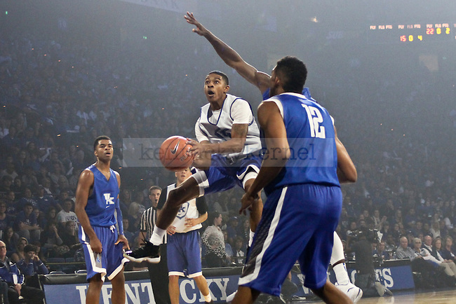 Freshman guard Tyler Ulis attacks the basket during Big Blue Madness in Rupp Arena in Lexington, Ky., on Friday, October 17, 2014. Photo by Jonathan Krueger | Staff