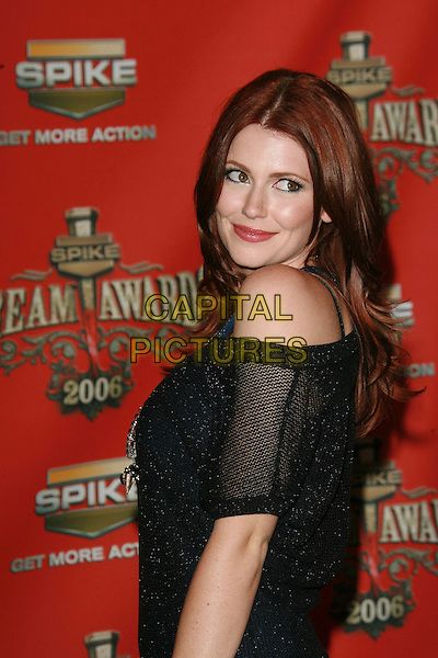 """DIORA BAIRD.At Spike TV's """"Scream Awards 2006"""", Press Room,. at the Pantages Theatre, Hollywood, California, USA, .7th October 2006..half length black looking back over shoulder.Ref: ADM/ZL.www.capitalpictures.com.sales@capitalpictures.com.©Zach Lipp/AdMedia/Capital Pictures."""