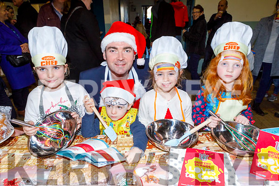 Minster Brendan Griffin TD launches the Ardfert NS love Cooking book at the Ardfert Community Centre on Sunday with Elsie Dowling, Oisin Roche, Elsie Roche and Emma Pierce.