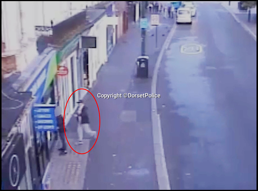 BNPS.co.uk (01202 558833)Pic: DorsetPolice/BNPS<br /> <br /> A screenshot of CCTV footage showing the moment Kevin Boyle attacked on Glen Morrant at around 6:25am on Friday 18th August 2017.<br /> <br /> Circled in red is Kevin Boyle.<br /> <br /> A knife maniac who nearly killed an innocent bystander he mistook for someone he had a row with because both men had ginger hair was today jailed for 21 years.<br /> <br /> Kevin Boyle waited outside a Bournemouth nightclub for the red-headed reveller who had shoved him two hours earlier to appear.<br /> <br /> When clubber Glen Morrant walked out Boyle began to follow him by mistake because he was wearing similar clothes to the first man and also had ginger hair.<br /> <br /> Boyle slashed the 19-year-old by the throat. He was sentenced today at Winchester Crown Court.