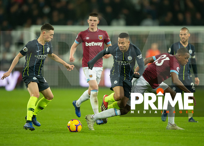Gabriel Jesus of Manchester City and Issa Diop of West Ham United battle for possession during the Premier League match between West Ham United and Manchester City at the Olympic Park, London, England on 24 November 2018. Photo by Vince Mignott / PRiME Media Images.