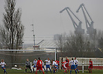 Tranmere Rovers Ladies 5 Middlesbrough Ladies 0, 22/01/2006. FA Women's premier League North. Tranmere Rovers Ladies (white) take on Middlesbrough Ladies in a FA Women's premier League (North) match at Poulton Victoria FC's ground in Wallasey with Birkenhead docks cranes in the background. Rovers defend a corner during their 5-0 victory.<br />  Photo by Colin McPherson.