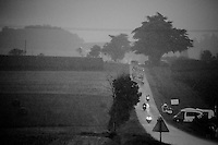 the peleton coming through a full blown storm<br /> <br /> 2014 Tour de France<br /> stage 19: Maubourguet - Bergerac (208km)