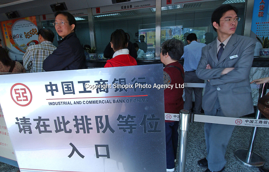 People queue at The Industrial and Commercial Bank of China in Guangzhou, China..